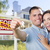 military couple in front of home house keys and sign stock photo © feverpitch