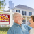 senior couple in front of sold real estate sign house stock photo © feverpitch