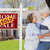 sold real estate sign with senior couple in front of house stock photo © feverpitch