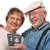 Happy Senior Couple with Passports and Bags on White stock photo © feverpitch