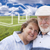 senior couple standing in grass field with ghosted house behind stock photo © feverpitch