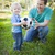 Young Boy and Dad Playing with Soccer Ball in Park stock photo © feverpitch