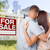 for sale real estate sign military couple looking at house stock photo © feverpitch