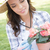 Young Adult Woman Wearing Hat Gardening Outdoors stock photo © feverpitch