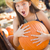 Preteen Girl Holding A Large Pumpkin at the Pumpkin Patch stock photo © feverpitch