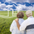 Senior Couple Standing in Grass Field Looking at Ghosted House stock photo © feverpitch