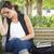 печально · молодые · студент · девушки · сидят · скамейке - Сток-фото © feverpitch