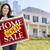 woman holding sold home sale sign in front of house stock photo © feverpitch