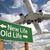 new life old life green road sign and airplane above stock photo © feverpitch