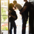 young son kissing pregnant mom with daddy in doorway stock photo © feverpitch