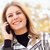 pretty young blond woman on phone outside stock photo © feverpitch
