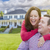 Happy Couple Outdoors In Front of Beautiful House stock photo © feverpitch