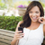 Young Adult Female Texting on Cell Phone Outdoors stock photo © feverpitch
