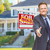 male agent reaching for hand shake in front of house and sold re stock photo © feverpitch