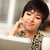 pretty smiling mixed race woman using laptop stock photo © feverpitch