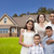 Young Hispanic Family in Front of Their New Home stock photo © feverpitch