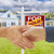 shaking hands in front of new house and sold sign stock photo © feverpitch