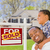 Mixed Race Father and Son In Front of Real Estate Sign and House stock photo © feverpitch