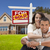 hispanic couple new home and sold real estate sign stock photo © feverpitch