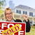 excited woman holding house keys and sold real estate sign stock photo © feverpitch