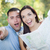 mixed race couple looking over map outside together stock photo © feverpitch