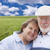 Loving Senior Couple Standing in Grass Field  stock photo © feverpitch