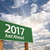2017 just ahead green road sign against clouds stock photo © feverpitch