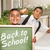boys giving thumbs up holding back to school chalk board stock photo © feverpitch