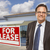 businessman in front of office building and for lease sign stock photo © feverpitch