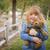 cute · glimlachend · jong · meisje · teddybeer · buiten - stockfoto © feverpitch