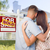 sold for sale sign with military couple looking at house stock photo © feverpitch