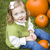 cute young child girl enjoying the pumpkin patch stock photo © feverpitch