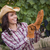 young adult female wearing cowboy hat and gloves in vineyard stock photo © feverpitch