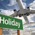 Holiday Green Road Sign and Airplane Above stock photo © feverpitch