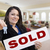 hispanic woman with keys and sold sign in living room stock photo © feverpitch