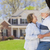 Happy Senior Couple in Front Yard of House stock photo © feverpitch