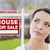 mixed race woman in front of house and foreclosure sign stock photo © feverpitch
