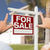 for sale sign house and military couple framing hands stock photo © feverpitch