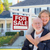 senior adult couple in front of real estate sign house stock photo © feverpitch