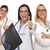 three female doctors or nurses with thumbs up holding x ray stock photo © feverpitch