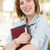 Smiling Young Female Student Outside with Books stock photo © feverpitch