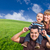 mixed race family in green grass field stock photo © feverpitch
