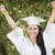 Happy Graduating Mixed Race Girl In Cap and Gown stock photo © feverpitch