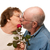 Happy Senior Husband Giving Red Rose to Wife stock photo © feverpitch