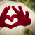 Woman Wearing Red Mittens Holding Out a Heart Hand Sign stock photo © feverpitch