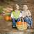 brother and sister children sitting on wood steps with pumpkins stock photo © feverpitch