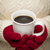 Woman in Sweater with Red Mittens Holding Cup of Coffee stock photo © feverpitch