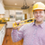 Contractor with Level Wearing Hard Hat Standing In Custom Kitche stock photo © feverpitch