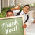 boys giving thumbs up holding thank you chalk board stock photo © feverpitch