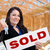 hispanic woman with keys and sold sign on site inside new home c stock photo © feverpitch